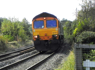 Goods Train At Level Crossing